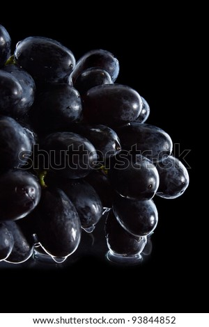 bunch of grapes isolated on black background - stock photo