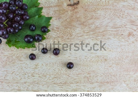 Bunch of grapes on a wooden background./ Bunch of grapes - stock photo