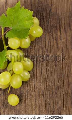Bunch of grapes over Wood Background - stock photo