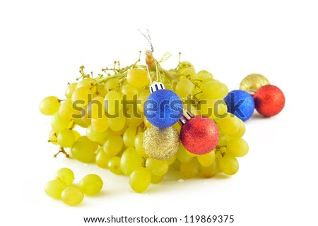 Bunch of grapes with Christmas toys closeup - stock photo