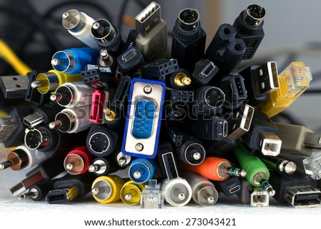 Bunch of great number of different colored cables with various connectors for various devices - stock photo