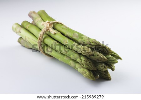 Bunch of green asparagus isolated White Background