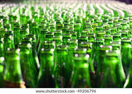Bunch of green glass bottles. Soft focus. - stock photo