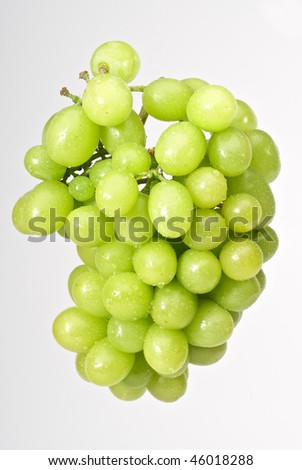 Bunch of green grapes isolated on white background - stock photo