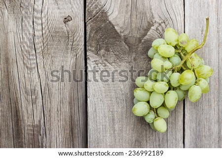 bunch of green grapes on the wooden background