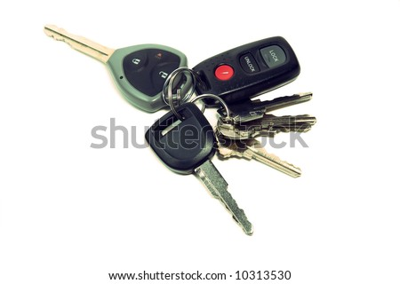 Bunch of house and car keys with remote isolated on white background - stock photo