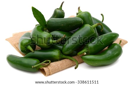 bunch of jalapeno peppers isolated on white  - stock photo