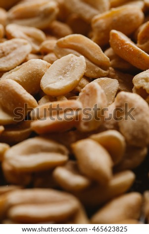 bunch of kernel peanuts on a blurred background closeup.