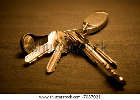 Bunch of keys on dark background. - stock photo