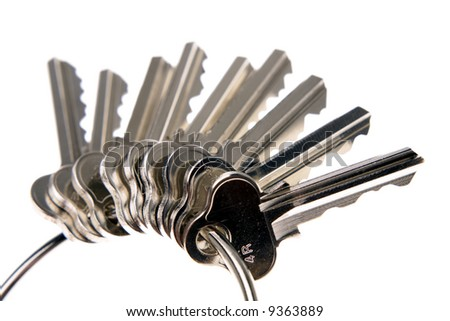Bunch of keys over white - stock photo