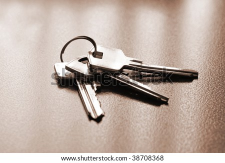 Bunch of keys toned in brown on office table - stock photo