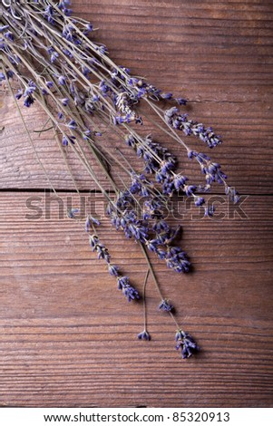Bunch of lavender flowers on wooden background - stock photo