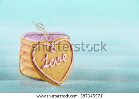 Bunch of love cookies on blue background - stock photo