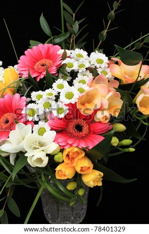 Bunch of many different flowers on black background - stock photo