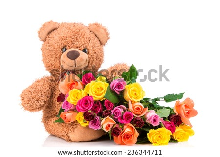 Bunch of mix color roses and a teddy bear on white background - stock photo