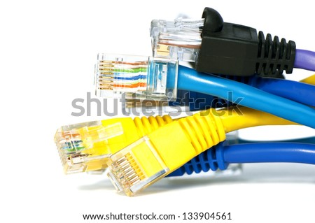 Bunch of multicolor RJ45 ethernet network cables' heads - stock photo