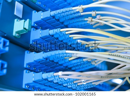 bunch of network cables in a data center - stock photo