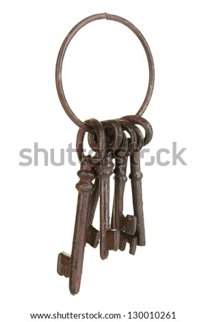 Bunch of old keys isolated on white - stock photo