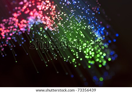 bunch of optical fibers flying from deep on technology background