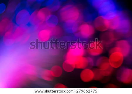 bunch of optical fibres flying from deep as blurred abstract technology background - stock photo