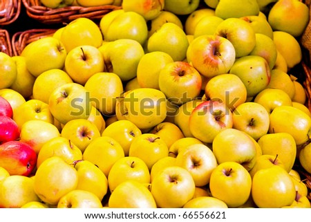 Bunch of organic fresh apples on a market - stock photo