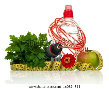 Bunch of parsley with skipping rope and bottle of water over white background - stock photo