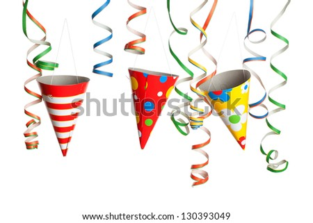 Bunch of party streamers and hats hanging in the air. Photographed in studio isolated on white background.