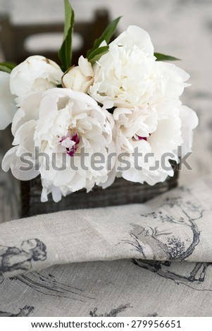 bunch of peonies flowers in a vintage box - stock photo