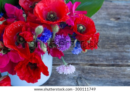 Bunch of Poppy, sweet pea and corn flowers close up   - stock photo