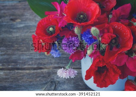 Bunch of Poppy, sweet pea and corn flowers close up, retro toned   - stock photo