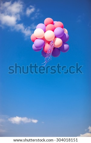 Bunch of purple and pink balloons in the sky