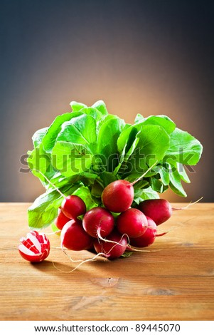 bunch of radishes on wooden - stock photo