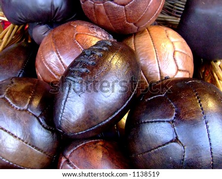 Bunch of real leather balls, old fashioned in a brushwood bucket - stock photo