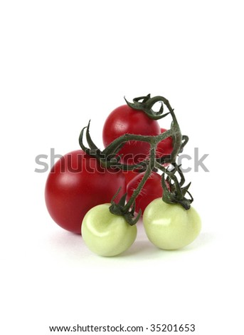 Bunch of red and green tomatoes on a white background