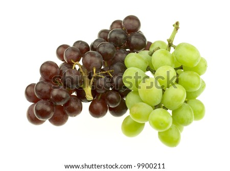 Bunch of red and white seedless grapes isolated on white background.