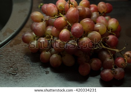 Bunch of red grapes on the black background - stock photo