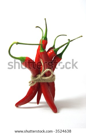bunch of red hot chilli chilies pepper, tied by rope - stock photo