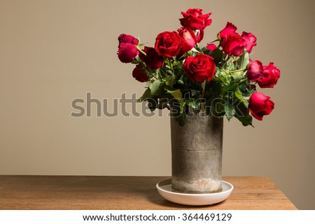 bunch of red rose in baked clay vase - stock photo