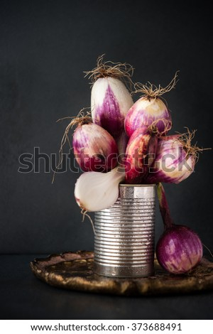 Bunch of red Tropea spring onions, sweet and tasty Italian red onion