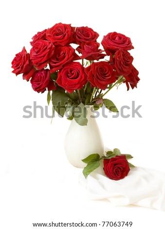 Bunch of red velvet roses in the vase isolated on white - stock photo