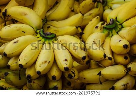 Bunch of ripe bananas at a street market - stock photo