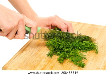 Bunch of ripe dill on a wooden board - stock photo