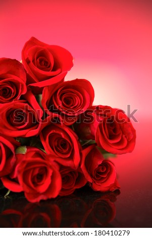 bunch of roses on pink background  - stock photo