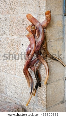 Bunch of shofars, or Jewish religious horns, on sale in the Old City of Jerusalem - stock photo