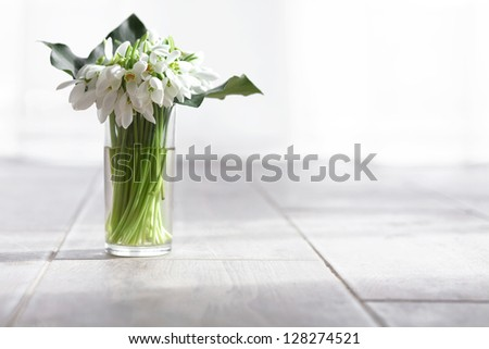 Bunch of snowdrops as a detail of the interior - stock photo