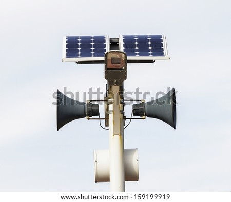 Bunch of speakers and solar cells. - stock photo