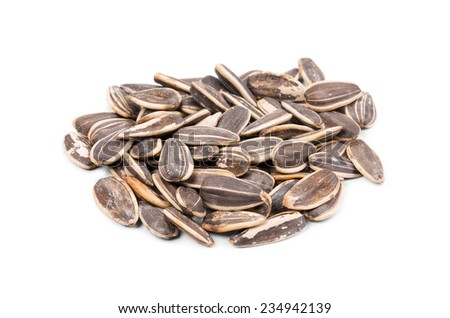 Bunch of sunflower seeds close up. Isolated on a white background.