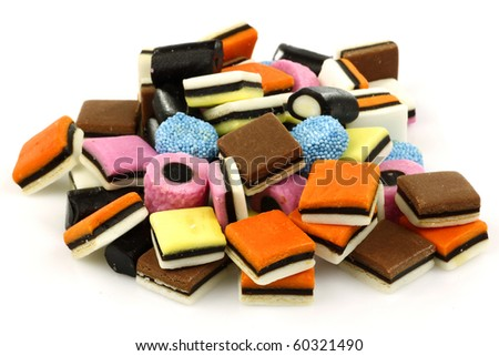 bunch of sweet, tasty and colorful licorice all sorts on a white background