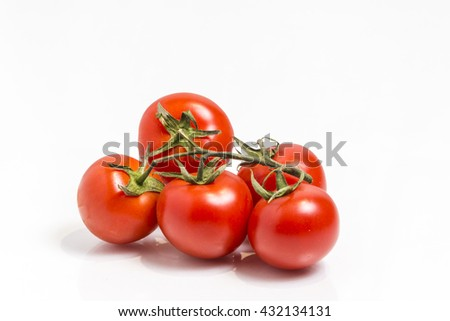 Bunch of the fresh red tomatoes,  isolated on white - stock photo