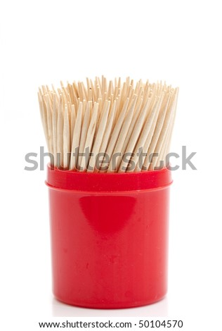 bunch of toothpicks in a red plastic container isolated against white background - stock photo